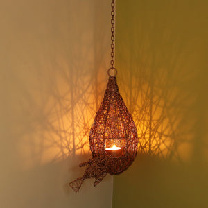 'Weaver Bird Mesh Nest' Handwoven Hanging Tea-Light Holder In Iron (11 Inch, Copper Finish)