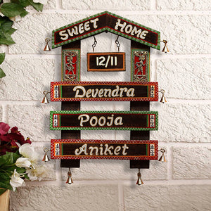 'Home Of The Heart' Customisable Hut Shaped Warli & Dhokra Wooden Name Plate With Handwritten Fonts