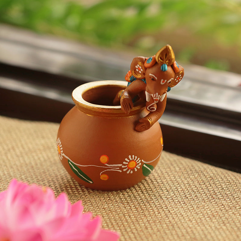 Terracotta Handpainted Baby Ganesha Crawling On The Matki