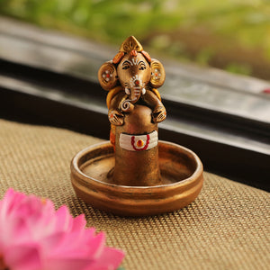Terracotta Handpainted Copper Finish Baby Ganesha Holding Lord Shiva In Pound