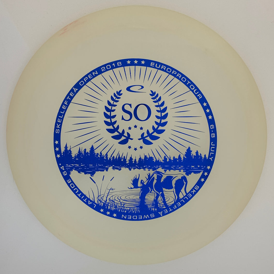 Latitude 64 Opto Moonshine Explorer - 18 Skellektea Open stamp
