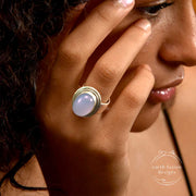 Oval Blue Chalcedony Brushed Sterling Silver Ring on Model's Finger