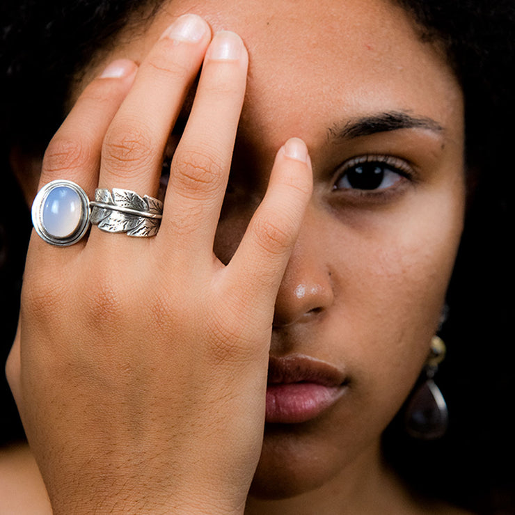 Oval Blue Chalcedony Brushed Sterling Silver Ring Alternate View on Model's Finger