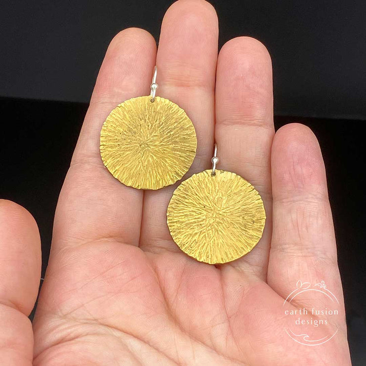Brass Radial Textured Disc Drop Earrings size comparison to hand