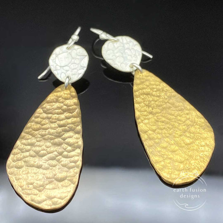 Textured Sterling Silver and Hammered Brass Abstract Earrings Laying Flat