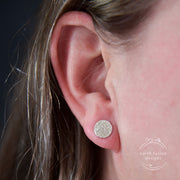 Sterling Silver Erosion Textured Disc Post Earrings on Model