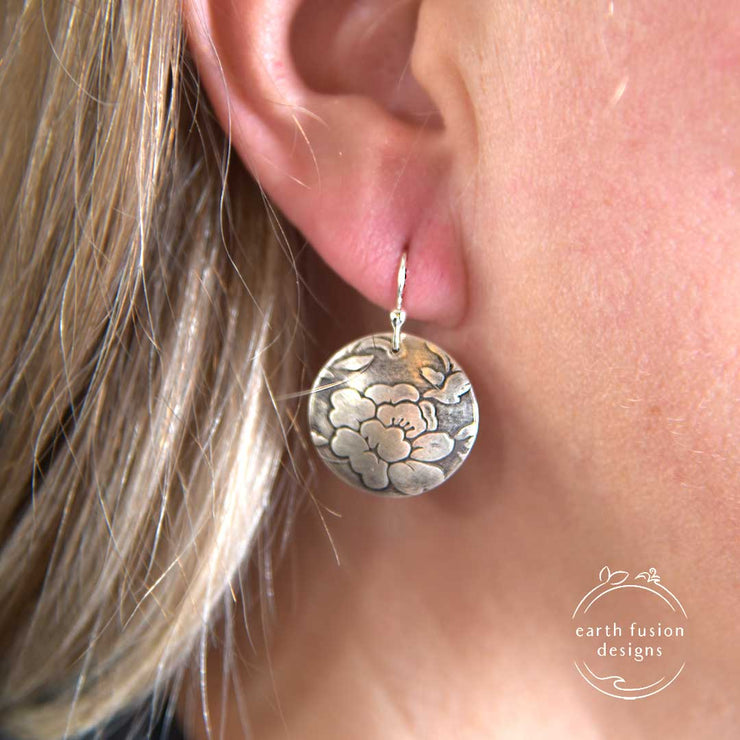 Sterling Silver Floral Textured Domed Medallion Earrings on Model