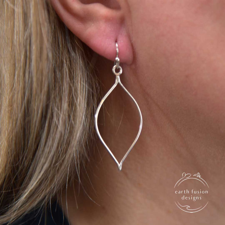Sterling Silver High Polished Teardrop Earrings on model