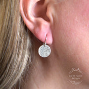 Sterling Silver Lotus Flower Stamped Disc Earrings on Model