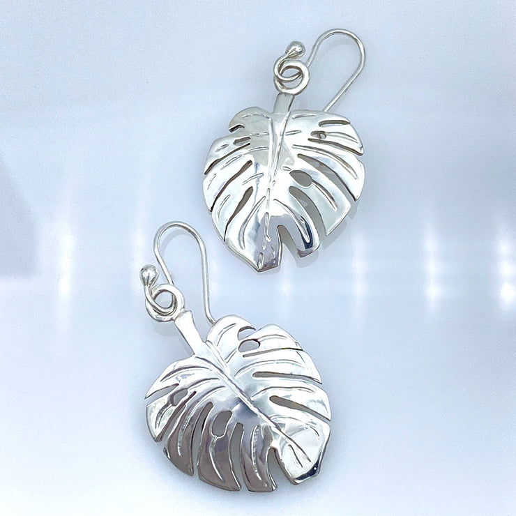 Sterling Silver Monstera Leaf Earrings laying flat