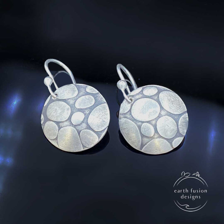 Sterling Silver Pebble Textured Disc Drop Earrings Laying Flat