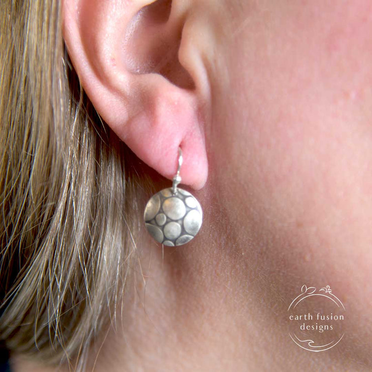 Sterling Silver Pebble Textured Disc Drop Earrings on Model
