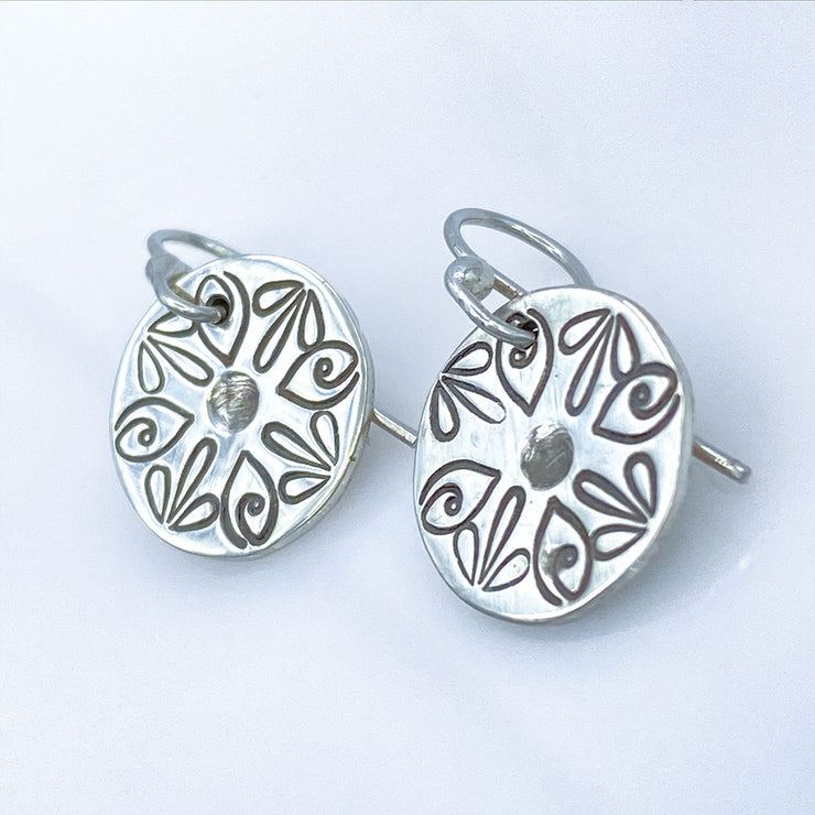 Sterling Silver Radiant Petal Stamped Disc Earrings Closeup