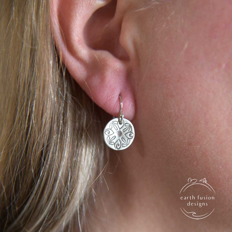 Sterling Silver Radiant Petal Stamped Disc Earrings on Model