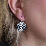 Sterling Silver Swirl Textured Domed Medallion Earrings on Model