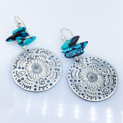 Turquoise Beaded Sterling Silver Stamped Medallion Earrings Laying Flat diagonal