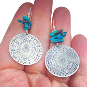 Turquoise Beaded Sterling Silver Stamped Medallion Earrings in comparison to a hand
