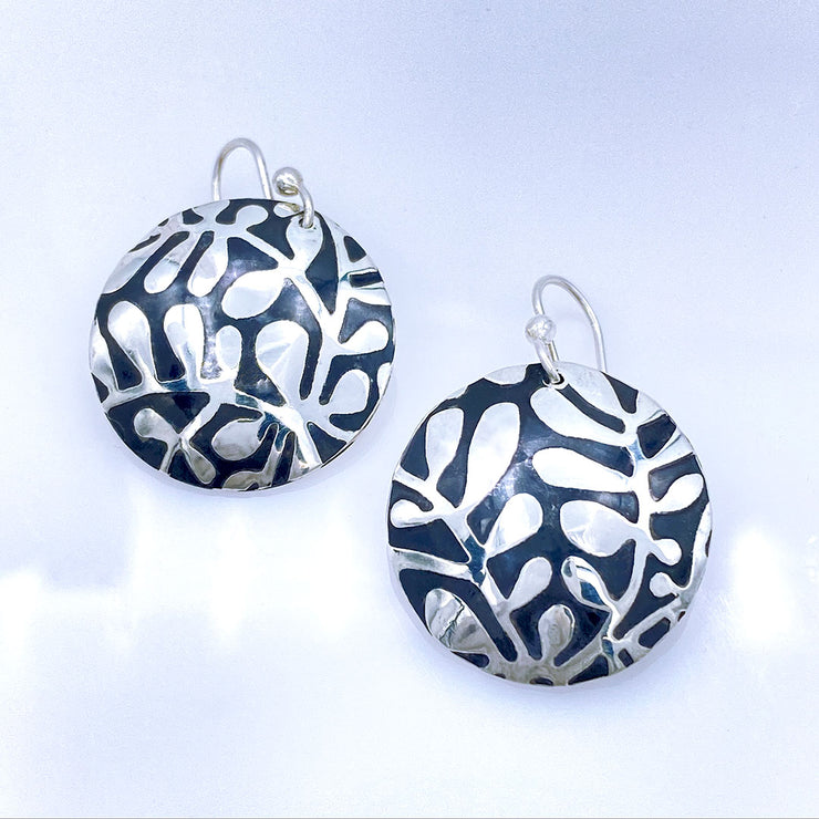 Sterling Silver Modern Vine Textured Domed Medallion Earrings laying flat