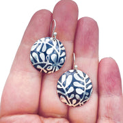 Sterling Silver Modern Vine Textured Domed Medallion Earrings size comparison to hand