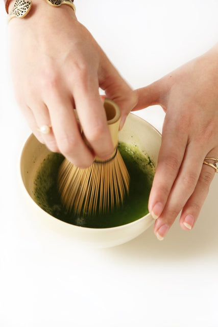 How to make matcha step 4 - pour water and whisk matcha with bamboo whisk