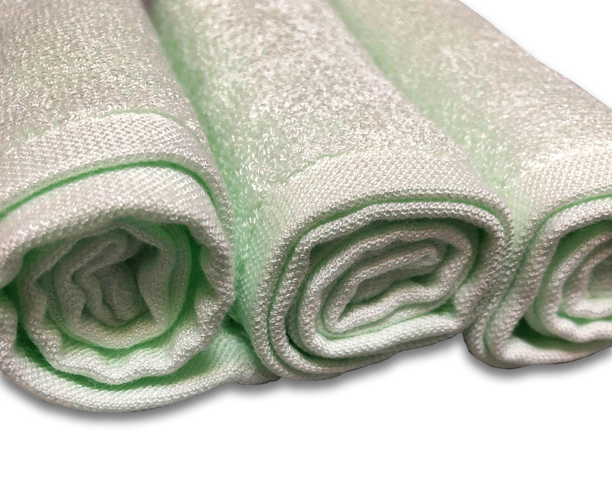 Set of three organic bamboo washcloths, colored green, with close up of fine and delicate texture.