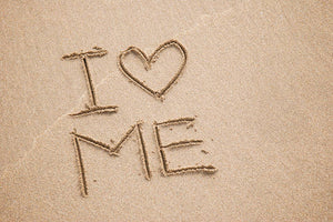 I heart me etched in sand in capital letters