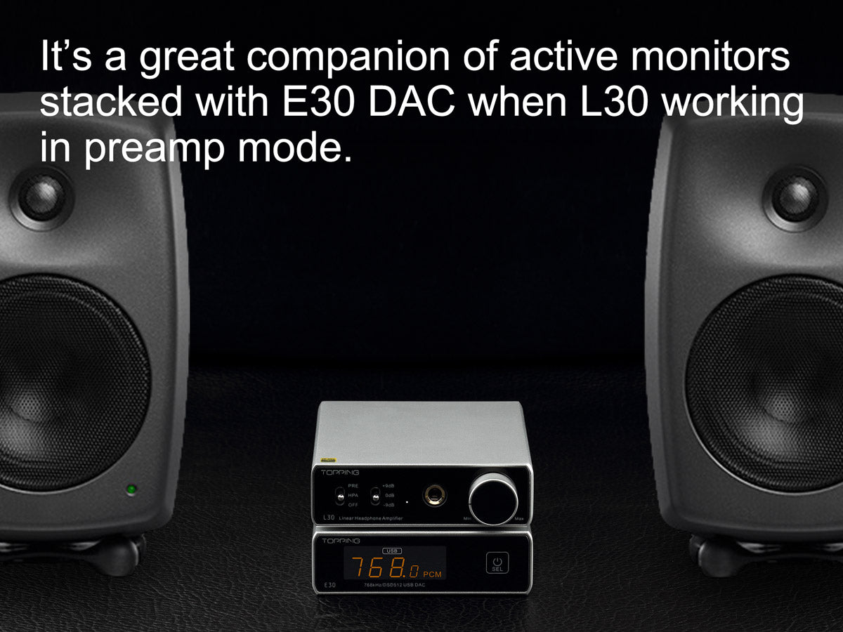TOPPING L30 headphone amplifier between two black studio monitors