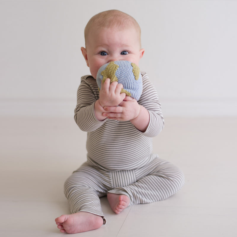 Baby with organic globe rattle