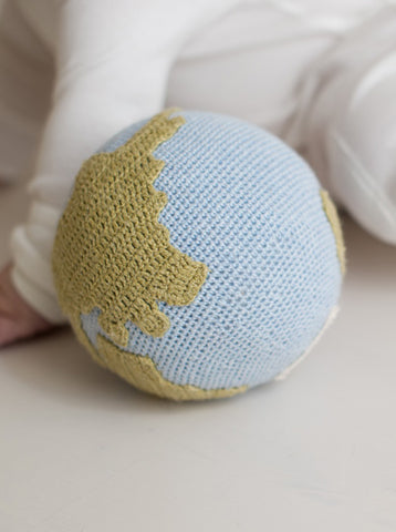 Hand crochet world globe rattle soft toy in colors blue and green