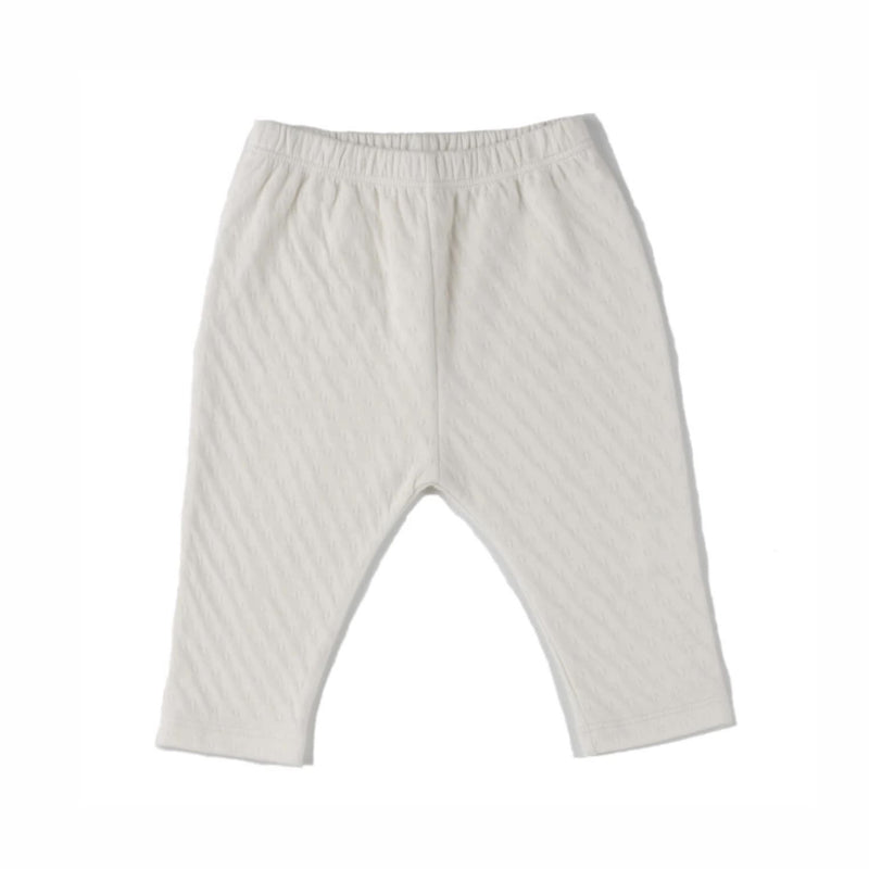 cream color straight leg pointelle ribbed pants with soft encased elastic at waistband. 100% organic cotton.