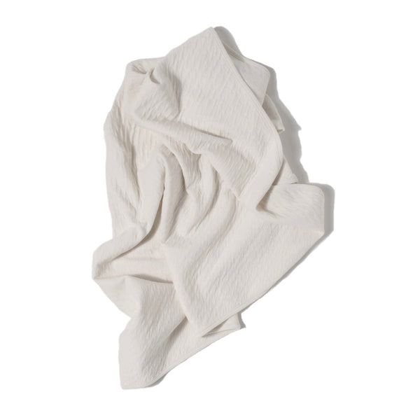 "cream color pointelle ribbed knit double layered essential swaddle blanket. 33"" x 33"".  100% organic cotton."