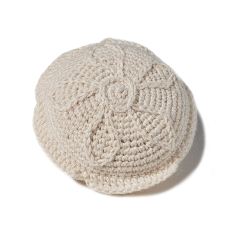 "natural organic soft toy in the shape of a sand dollar with a rattle inside and at 4"" in diameter..  100% organic cotton hand crochet knit."