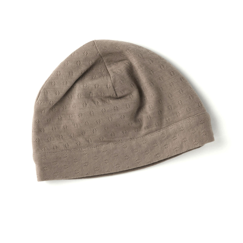 cool dark brown pointelle knit skull cap in double layered pointelle, for newborns, made with 100% certified organic cotton