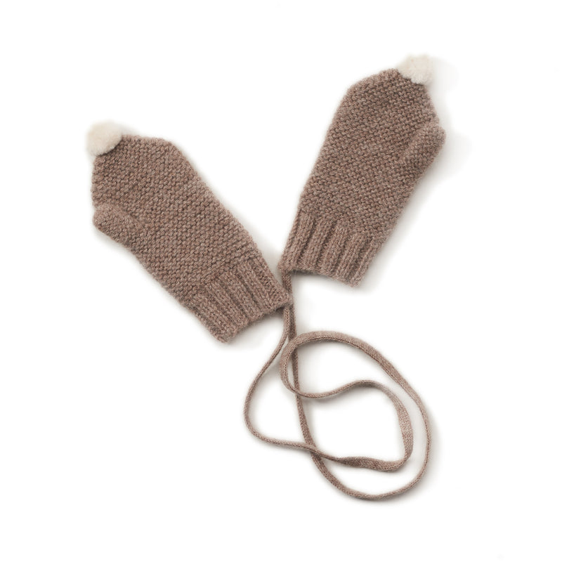 dark tan mittens with white pom atop, cord for inside sleefves, handmade with 100% melanged alpaca