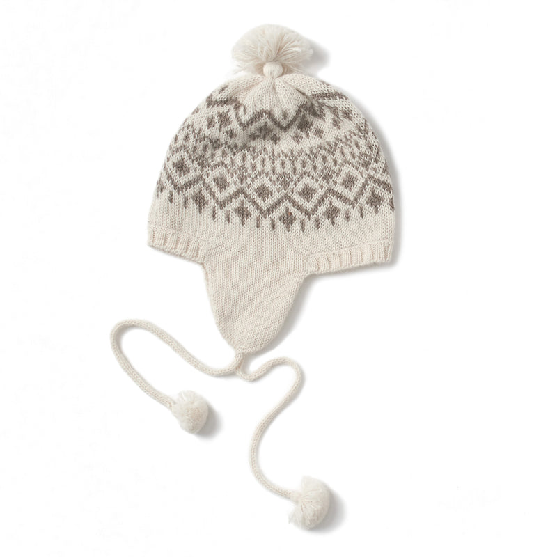 soft white fairisle pattern hat with flaps and ties with pom-poms at the end, tassels on top, handmade with 100% baby alpaca