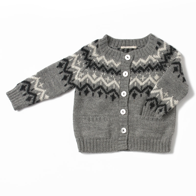 dark grey, crew neck cardigan with a fair isle pattern, has natural shell buttons, handmade with 100% baby alpaca, has two front pockets on the bottom
