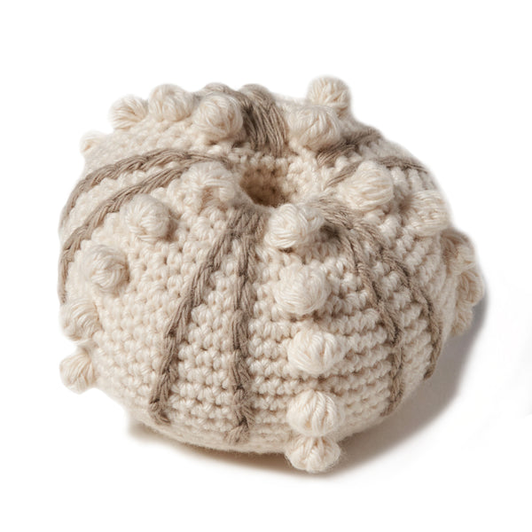 "natural organic soft toy in the shape of a sea urchin with a rattle inside and at 3 1/2"" in diameter..  100% organic cotton hand crochet knit."