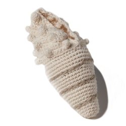 "natural organic soft toy in the shape of a shell with a rattle inside and at 5 1/4"" in length.  100% organic cotton hand crochet knit."