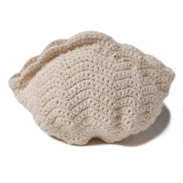 "natural organic soft toy in the shape of a sea scallop shell with a rattle inside and at 5"" in width.  100% organic cotton hand crochet knit."