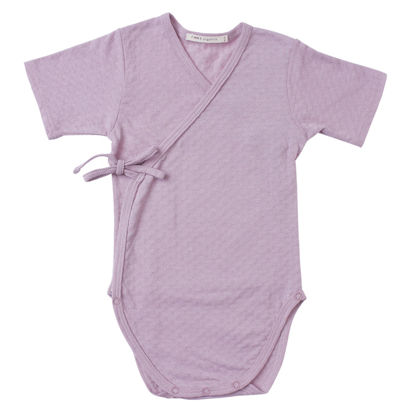 lavender color pointelle short sleeved double front kimono wrap onesie.  100% organic cotton.