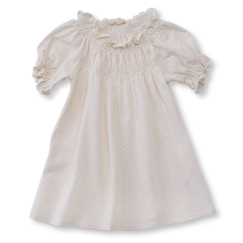 cream color pointelle short sleeved dress with soft elastic gathering at neckline and cuffs.  100% organic cotton pointelle knit.