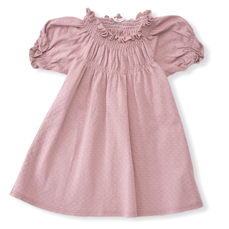 rose color pointelle short sleeved dress with soft elastic gathering at neckline and cuffs. 100% organic cotton pointelle knit.