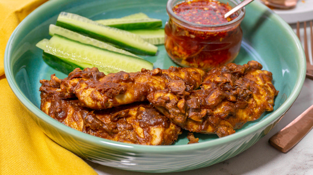Healthy low carb chicken satay strips served with cucumber and sweet chilli sauce