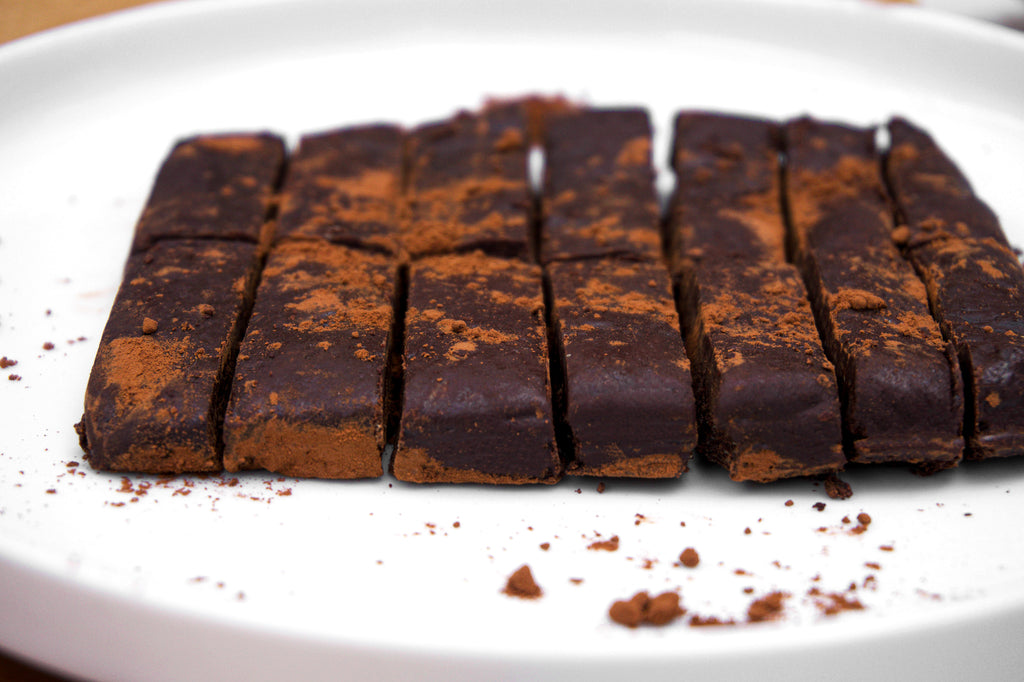 Side view of homemade chocolate bar dusted with cacao powder