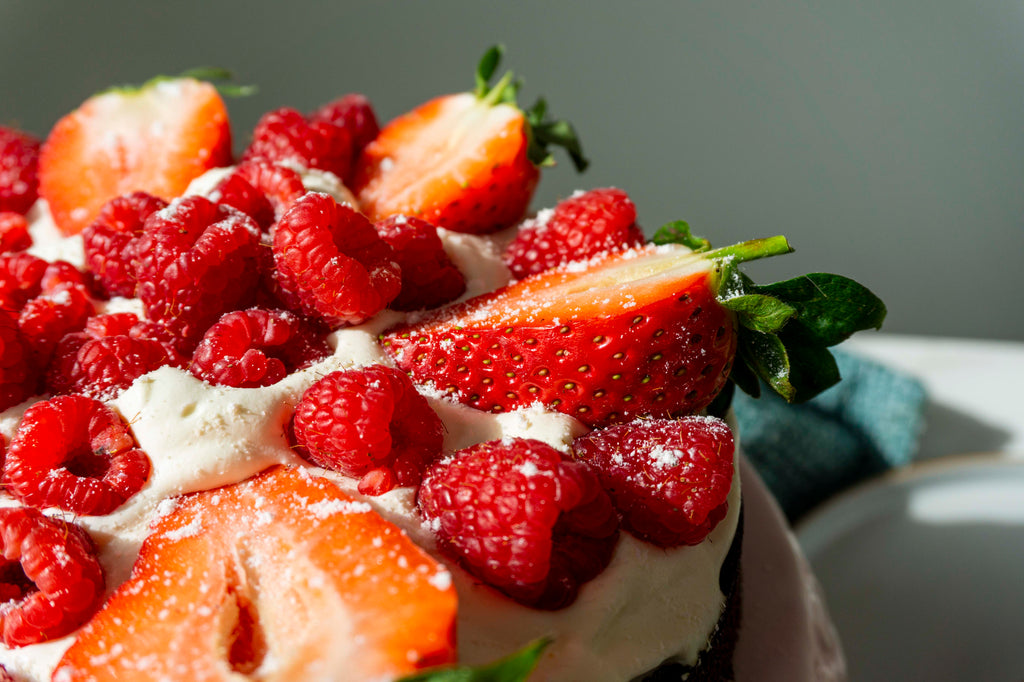 Fresh berries on top of a low carb chocolate Primal cake