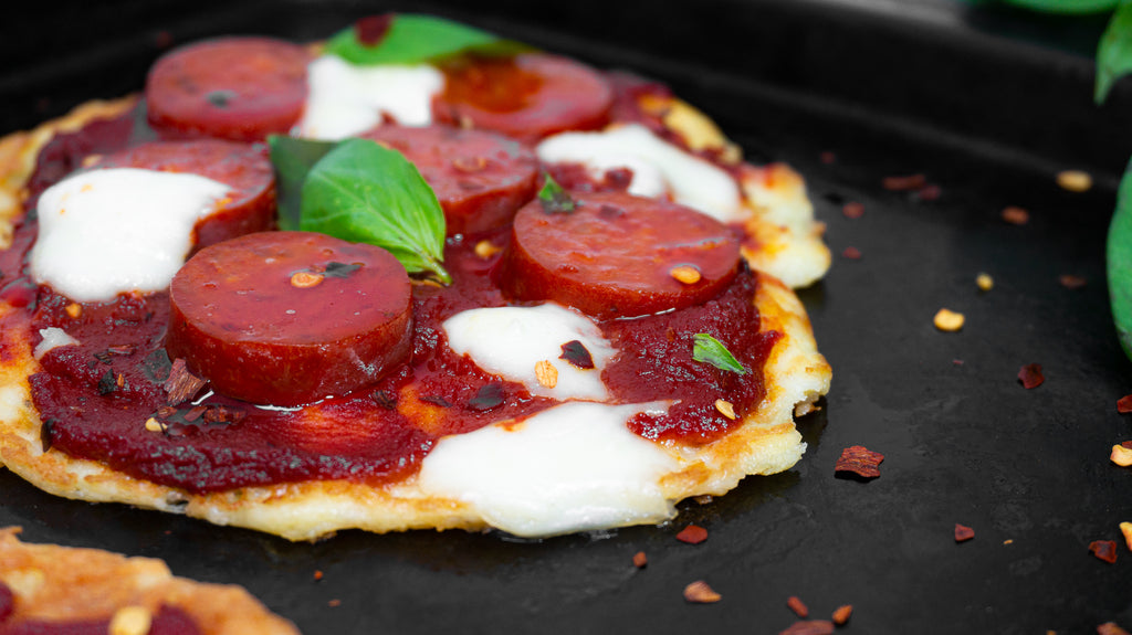 Ozzing mozzarella on top of low carb pizza pancakes.