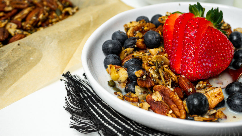 Keto Granola served with berries and milk