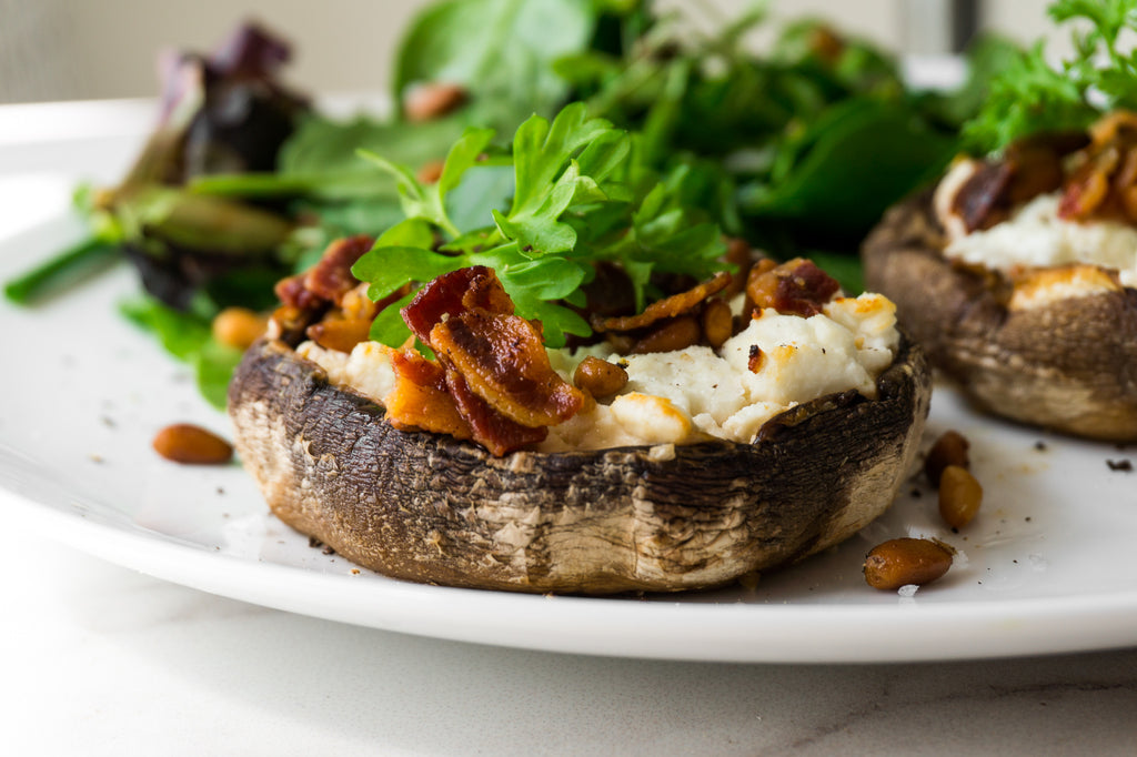 Side view of stuffed portobello mushrooms with goats cheese and crispy bacon