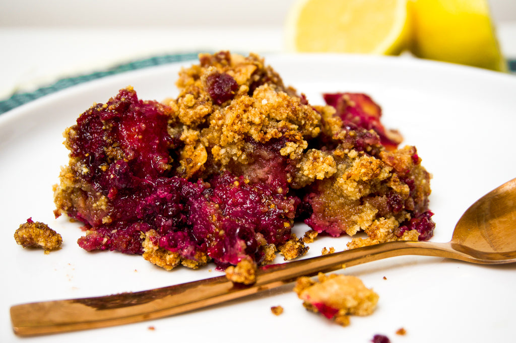 Healthy pineapple and blackberry crumble served up on a plate