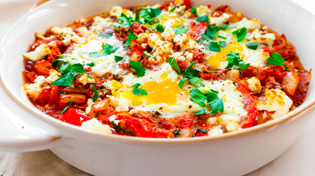 Low carb tuna shakshuka ready to serve with crumbled feta cheese and fresh parsley